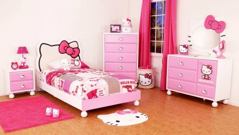 Girl's-hello-kitty-bedroom-with-a-bed-a-cupboard-a-lamp-table-and-dressing-table-complete-by-pink-curtain-and-rug-also-mat-