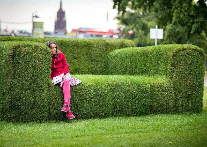 "A woman sits on a grass-made sofa in Frankfurt, western Germany on September 12, 2012. The so-called ""Main-Sofa"" was initiated by Federal Minister for Environment Puttrich to highlight the upcoming event of the ""Tag der Nachhaltigkeit"" (Day of Sustainability) on September 19, 2012. AFP PHOTO / FRANK RUMPENHORST GERMANY OUT"