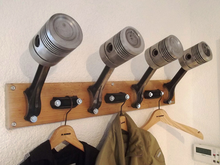 22.ALH24-auto-parts-creatively-turned-into-man-cave-furniture-piston-coat-rack