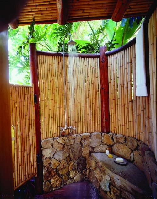 outdoor-shower-enclosure-covered-with-bamboo-and-stone