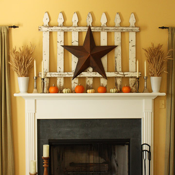 cute-halloween-fireplace-decorating-ideas-bronze-star-on-a-white-fence-decoration-small-orange-pumpkins-four-candle-stands-on-a-mantel